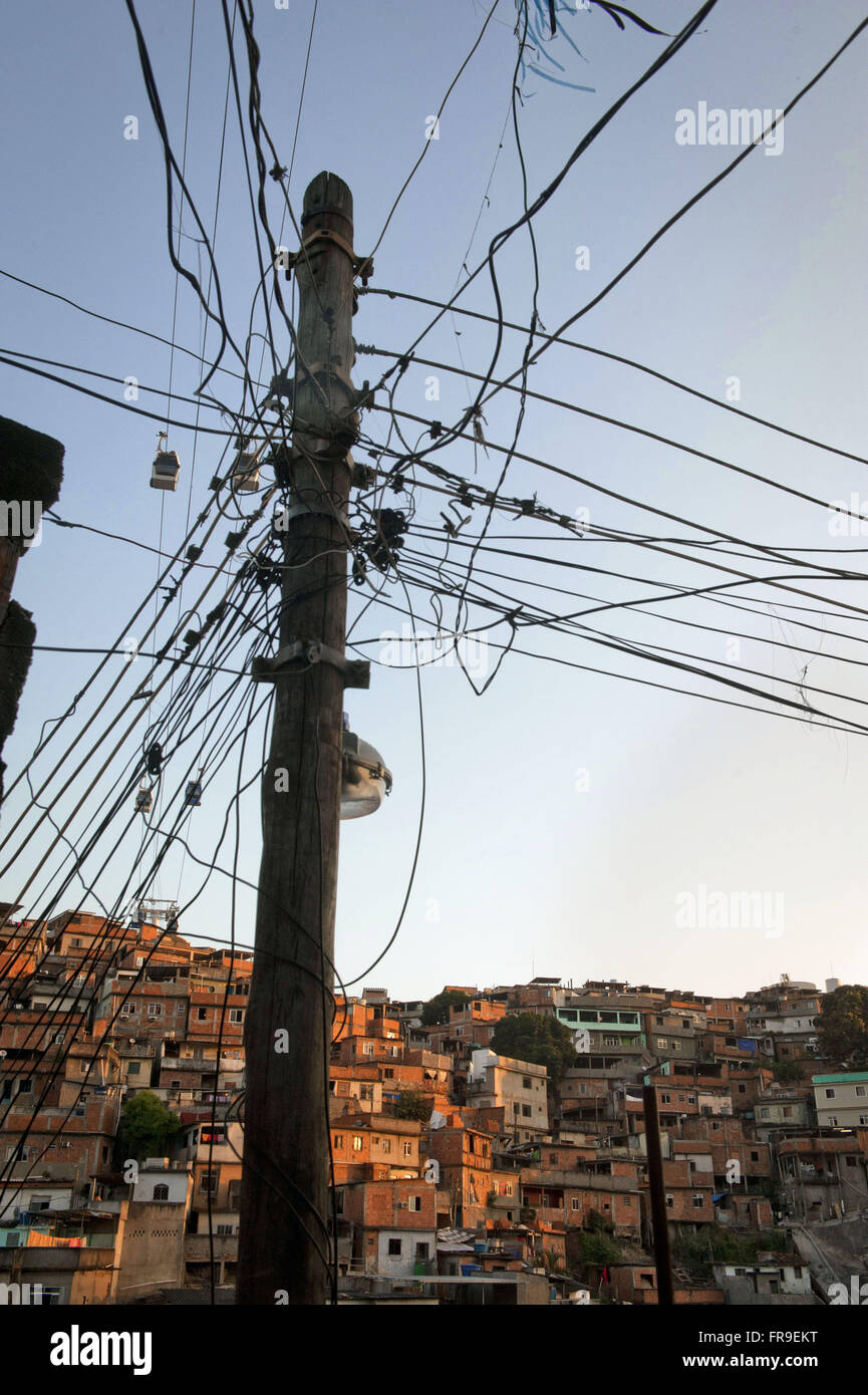 Underground wiring cat calls slum Complexo do Alemao Stock Photo ...