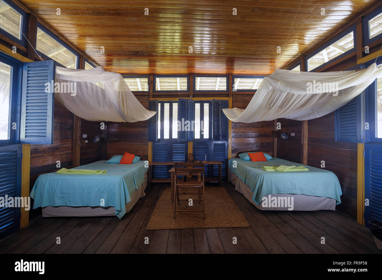 Inside view of one of the bungalows of the floating hostel Uacari - Stock Image