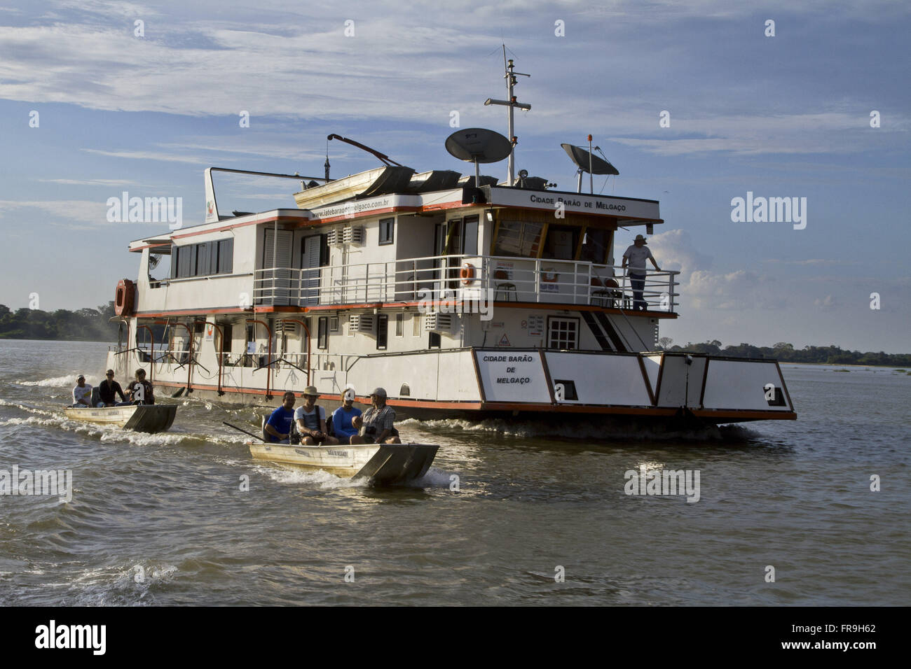 Boats and punt a touristy tour and sport fishing in the Rio Paraguay - Stock Image