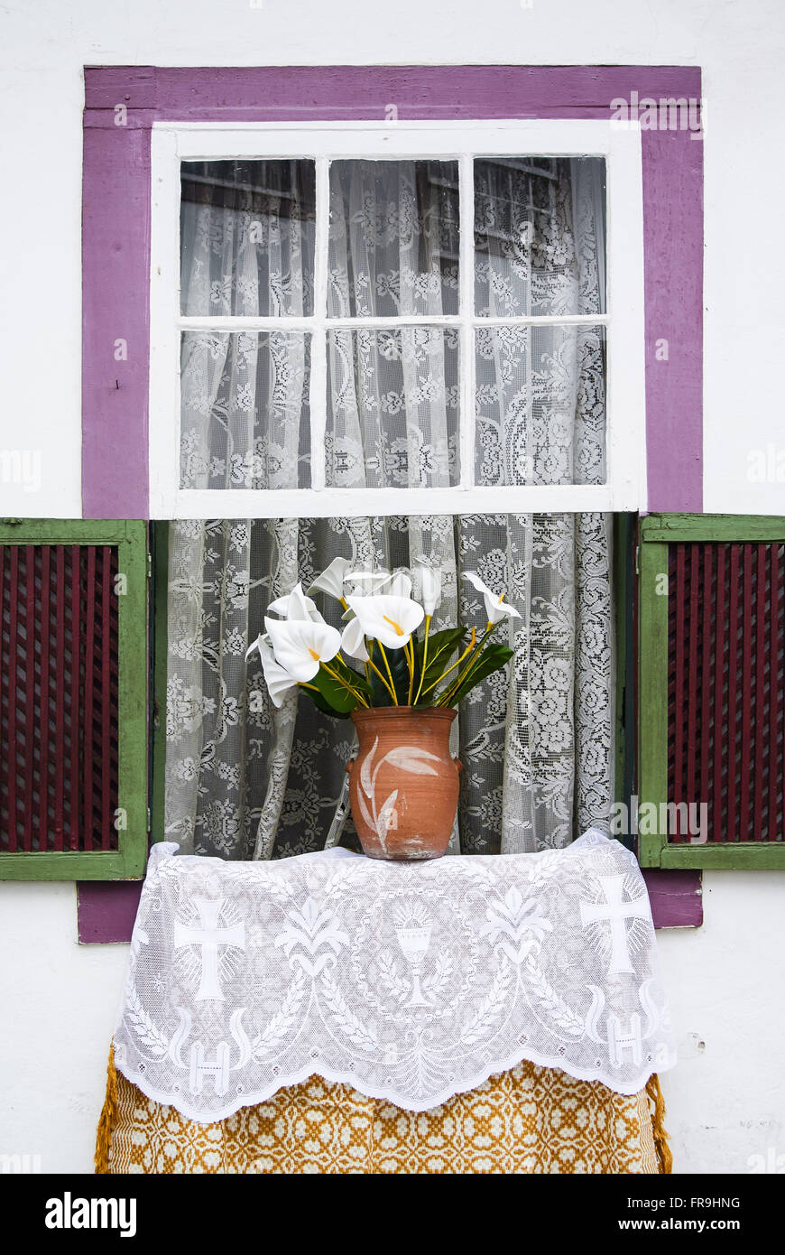 Window decorated with flower vase for the festivities of Corpus Christi - Stock Image