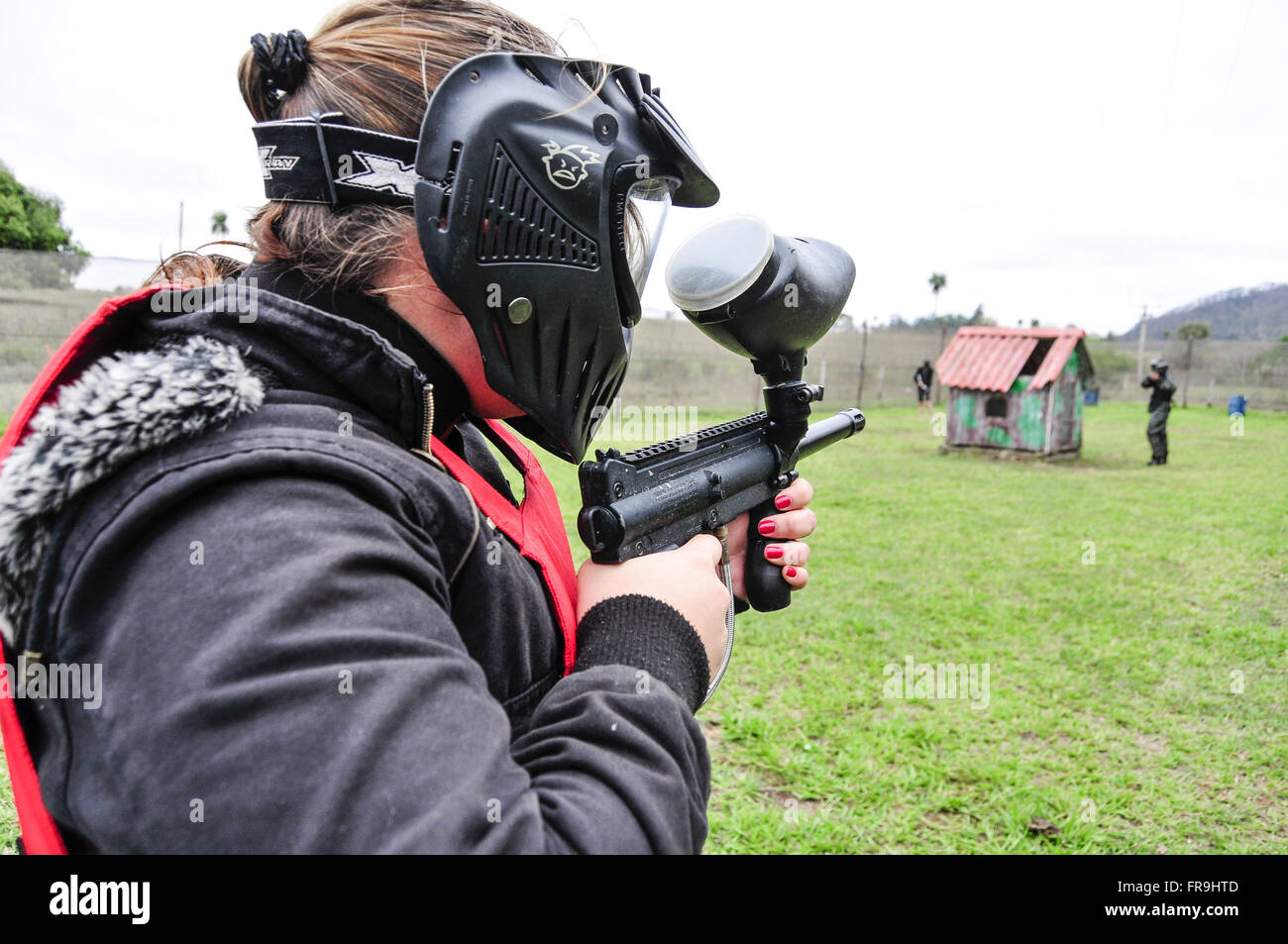 Paintball - combat sport team with gun that shoots balls of colored ink - Stock Image