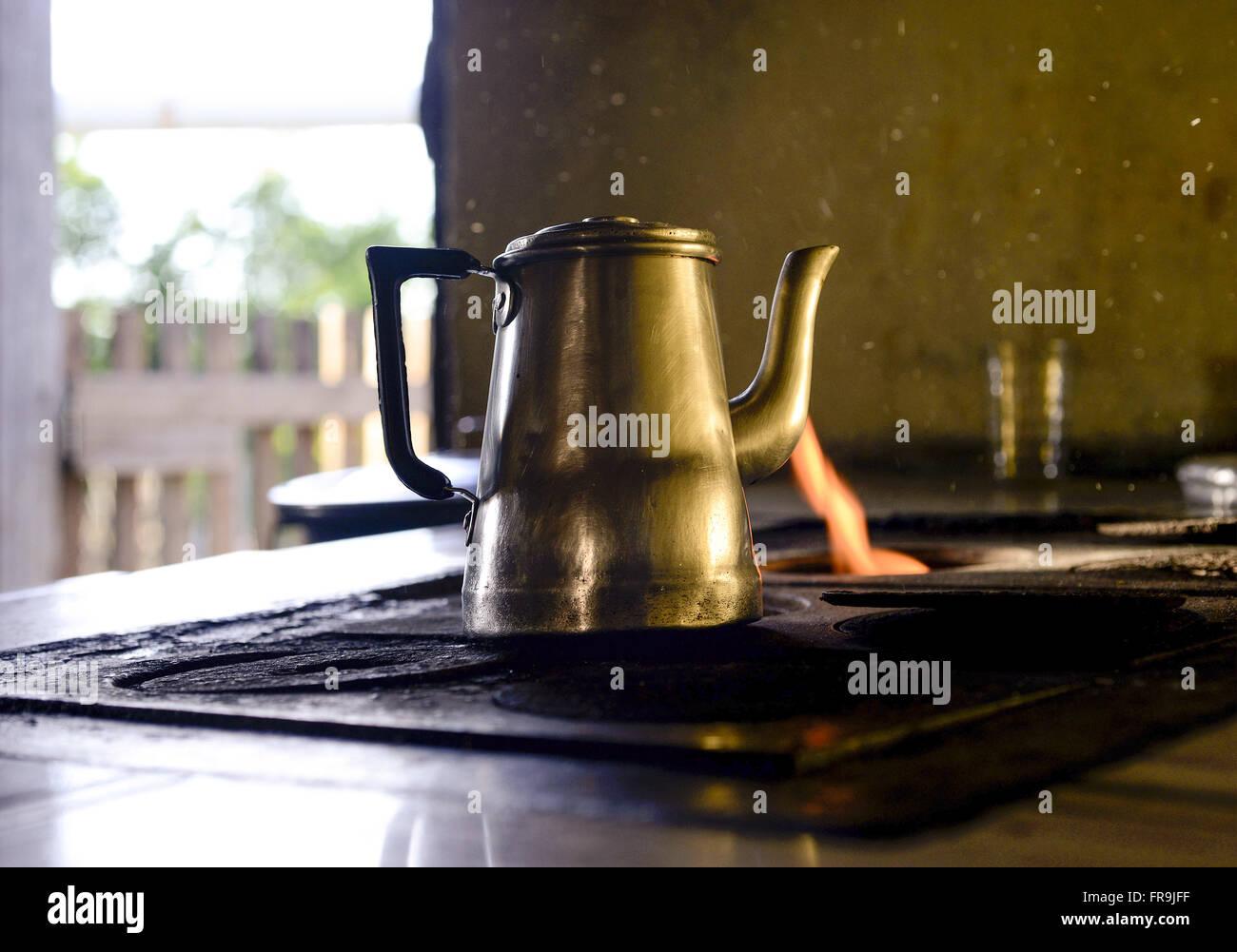Teapot on wood stove - region of Jararaca - Stock Image