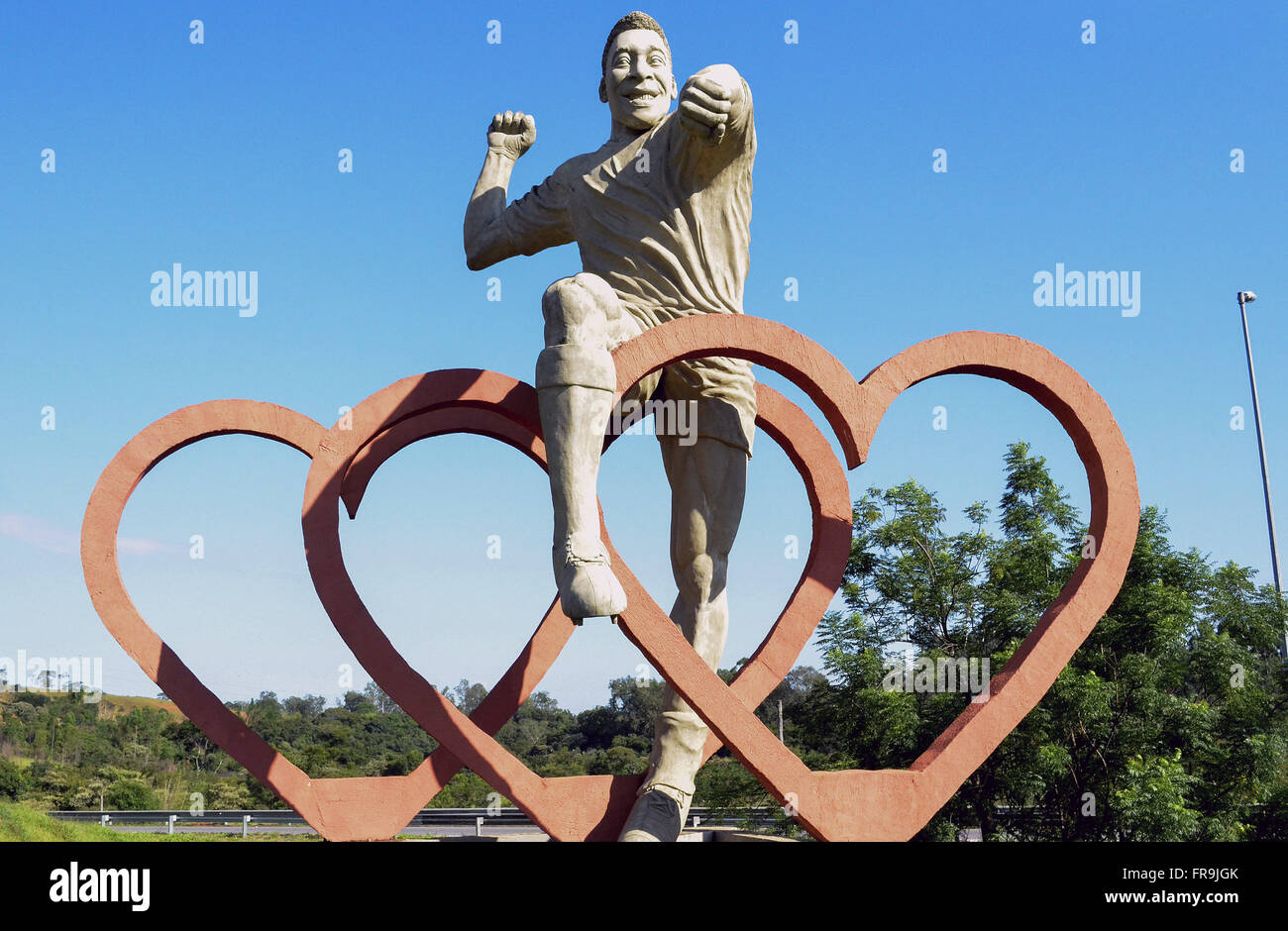 Statue in honor of the football player Pele - Stock Image