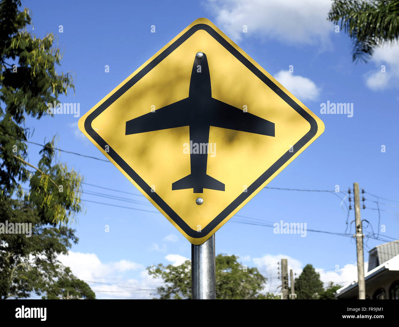 Vertical signpost of airport indication in Bacacheri district. - Stock Image