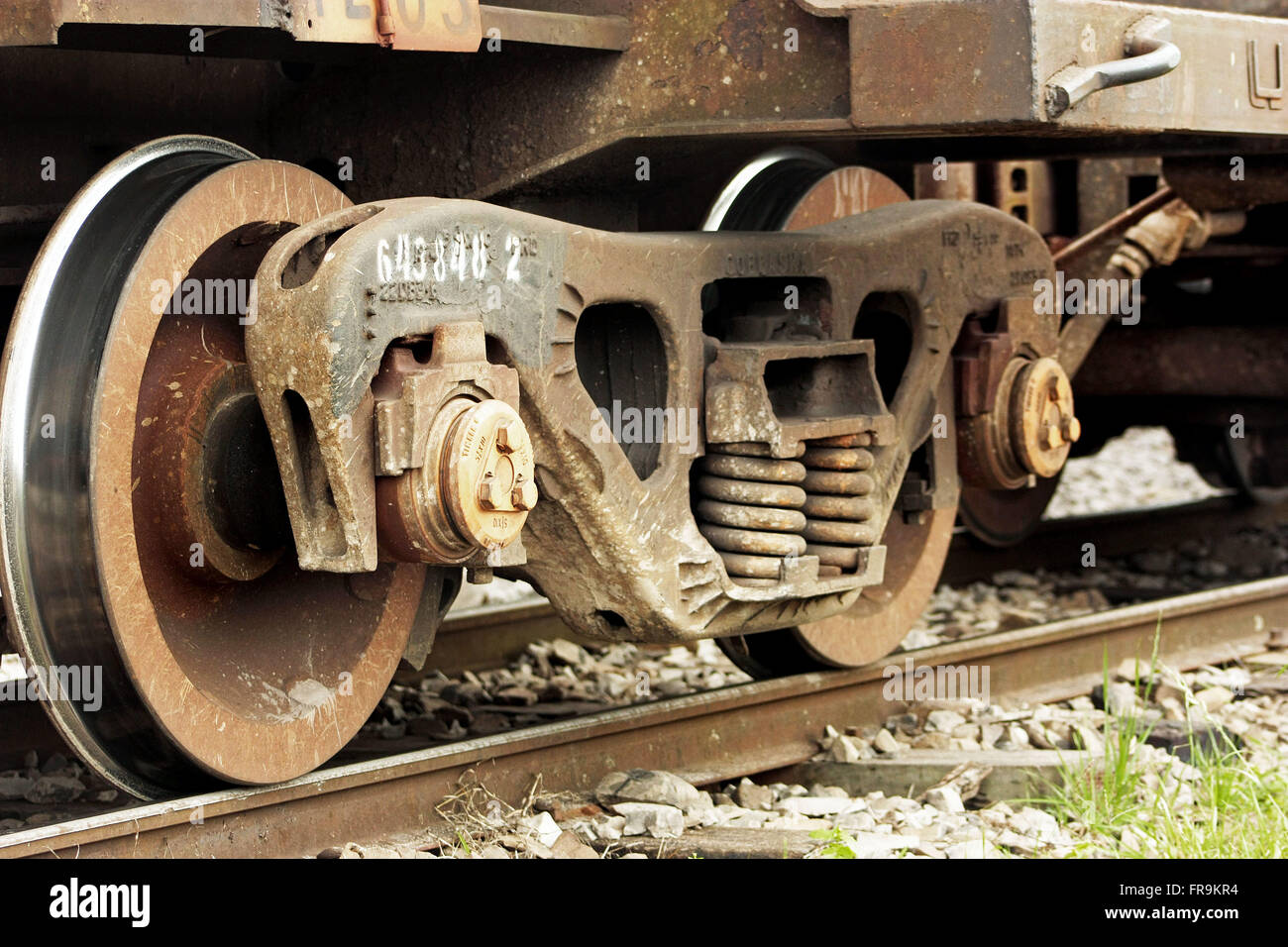 Detail of train wheels on rails - Stock Image
