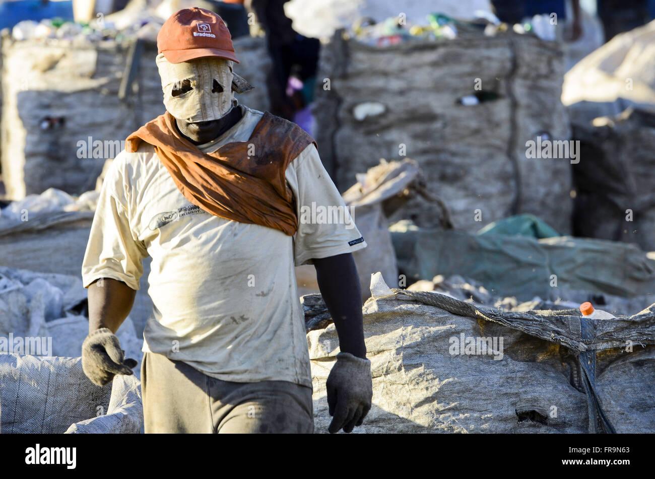 Collector and bags of recyclable garbage collected on Sanitary Landfill of Jardim Gramacho - Stock Image