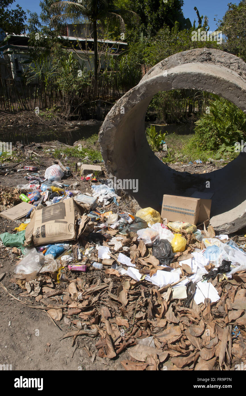 Garbage and open sewage stream at the edge of the municipality of Mage - Stock Image