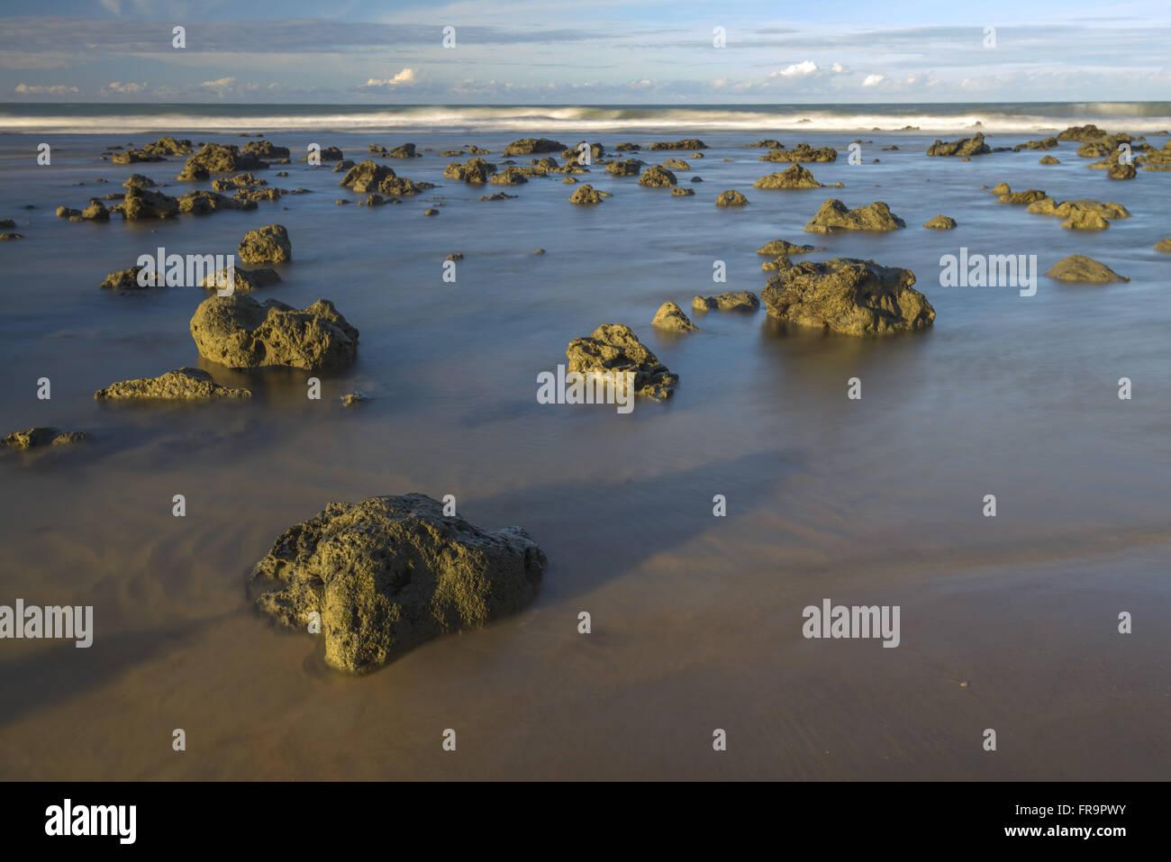 Formações rochosas na Praia do Amor ao entardecer - Stock Image