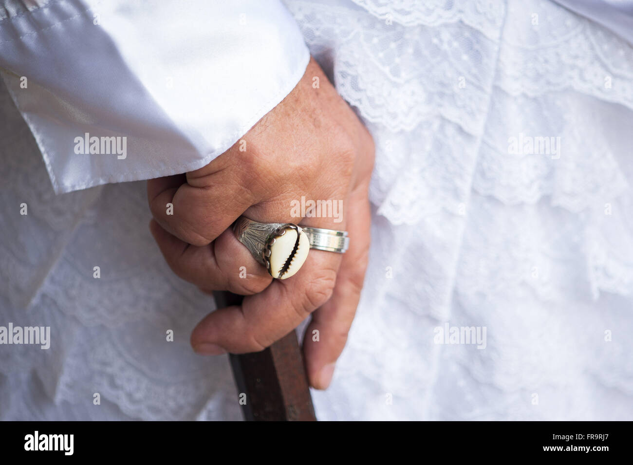 Detail of the hand of a member of the Mozambique group of Saint Benedict - Stock Image