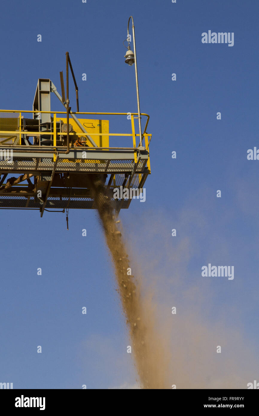 Conveyor belt to transport gravel mining grinding rocks - Stock Image