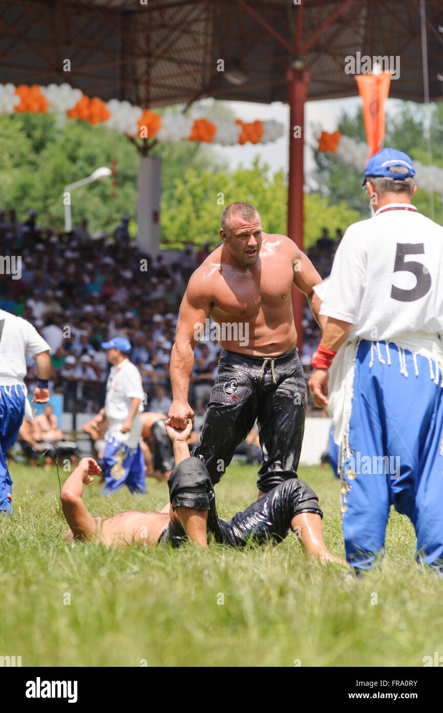Wrestlers Turkish pehlivan at the competition in traditional Kirkpinar wrestling. Stock Photo