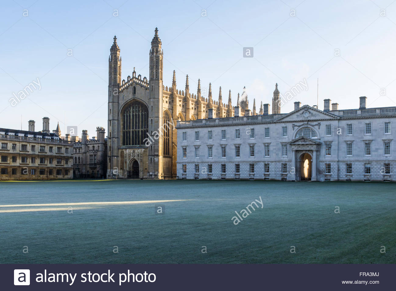 Early morning frost and long shadows on the lawns in front of Kings College Chapel in Cambridge - Stock Image
