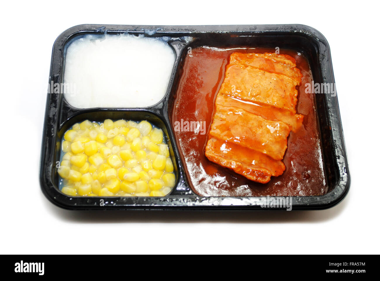 BBQ Pork TV Dinner with Corn and Potatoes - Stock Image