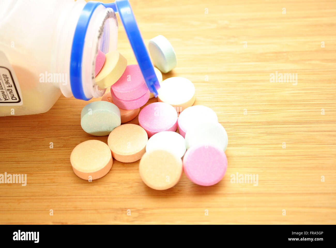 Over the Counter Antacids Falling out of the Bottle - Stock Image