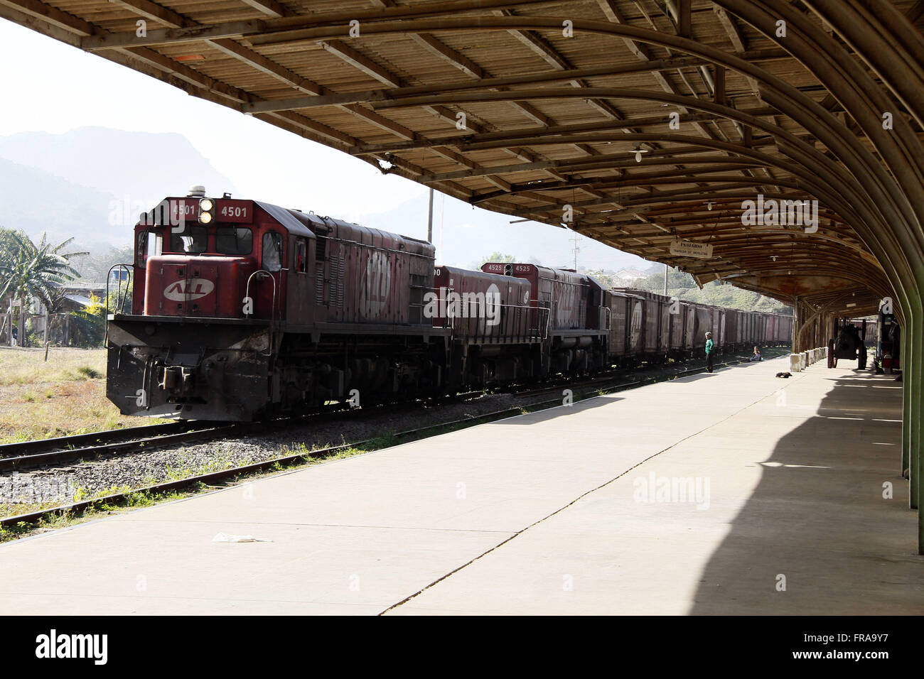 Two locomotives pulling freight train wagons on railway administered by ALL - Stock Image