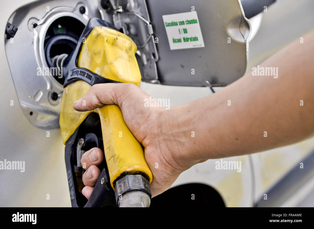Automobile fueling station attendant - Stock Image