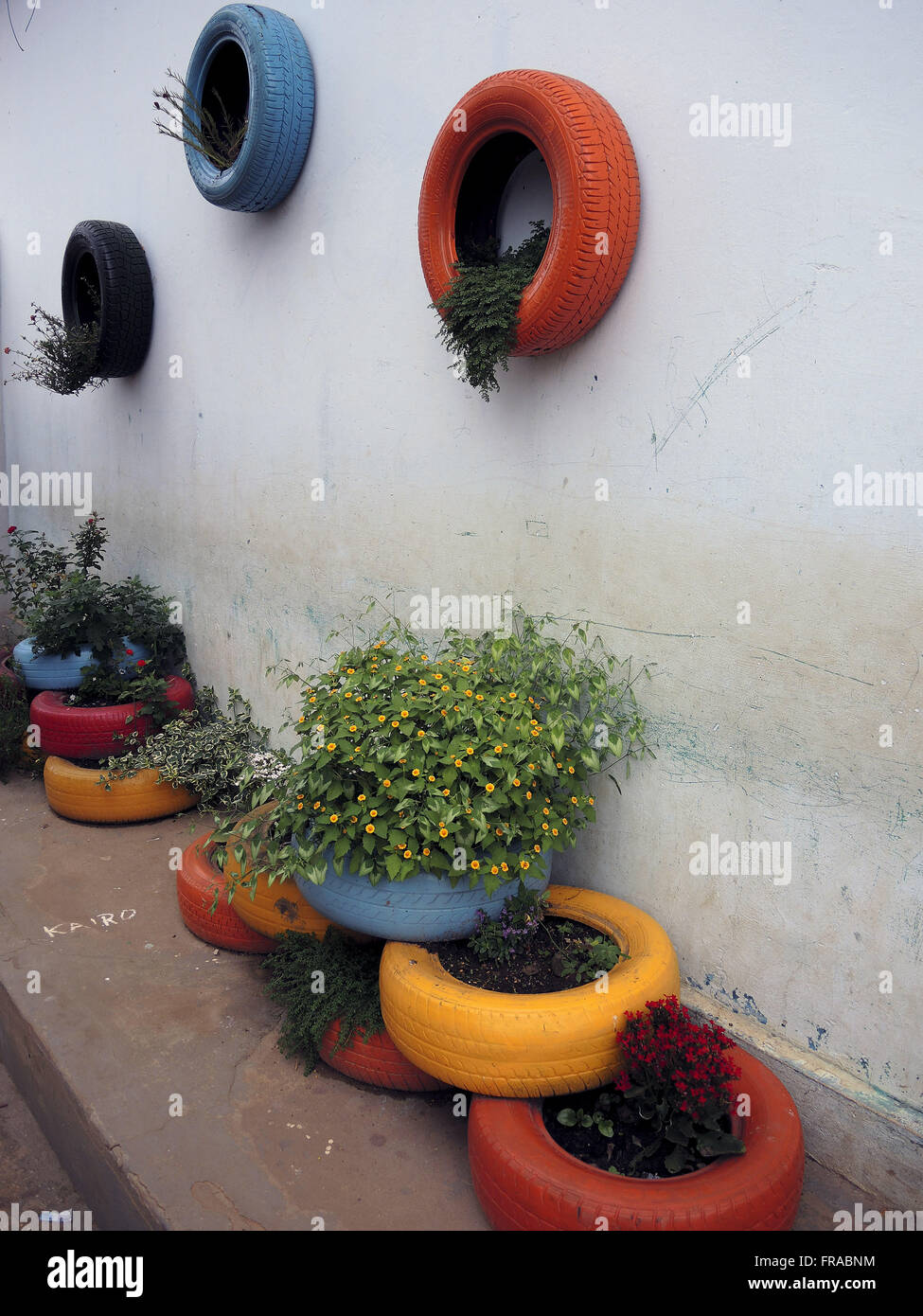 Garden made of recyclable material in public schools - Stock Image