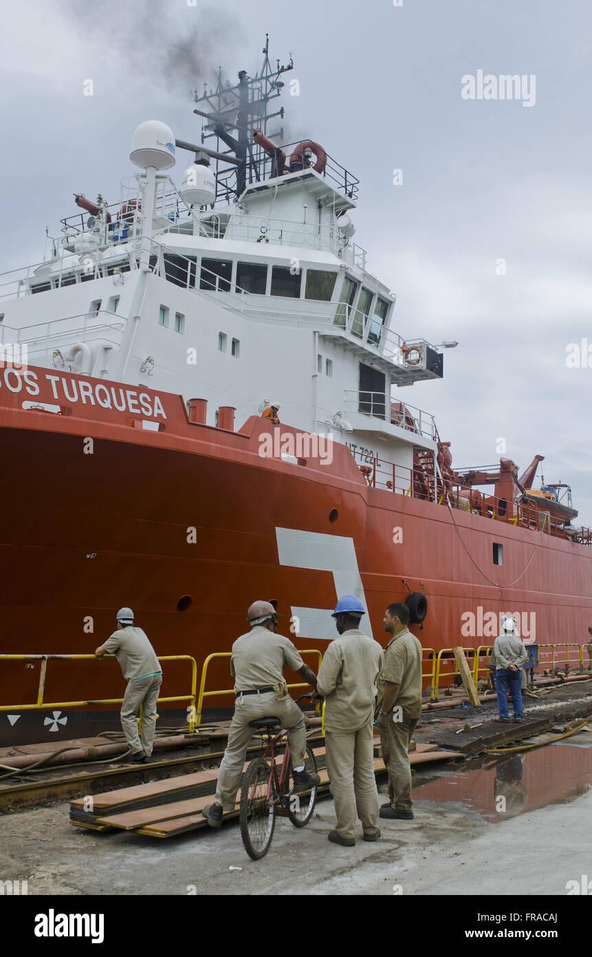 Tug BOS TURQUOISE starting after retirement Shipyard Enavi / Renavi - neighborhood Barreto - Stock Image