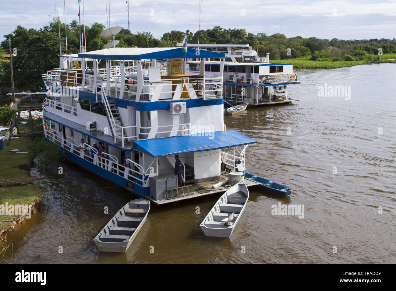 Lighters to visit and tour sportfishing anchored in the region of Porto Cercado on Rio Cuiaba - Stock Image