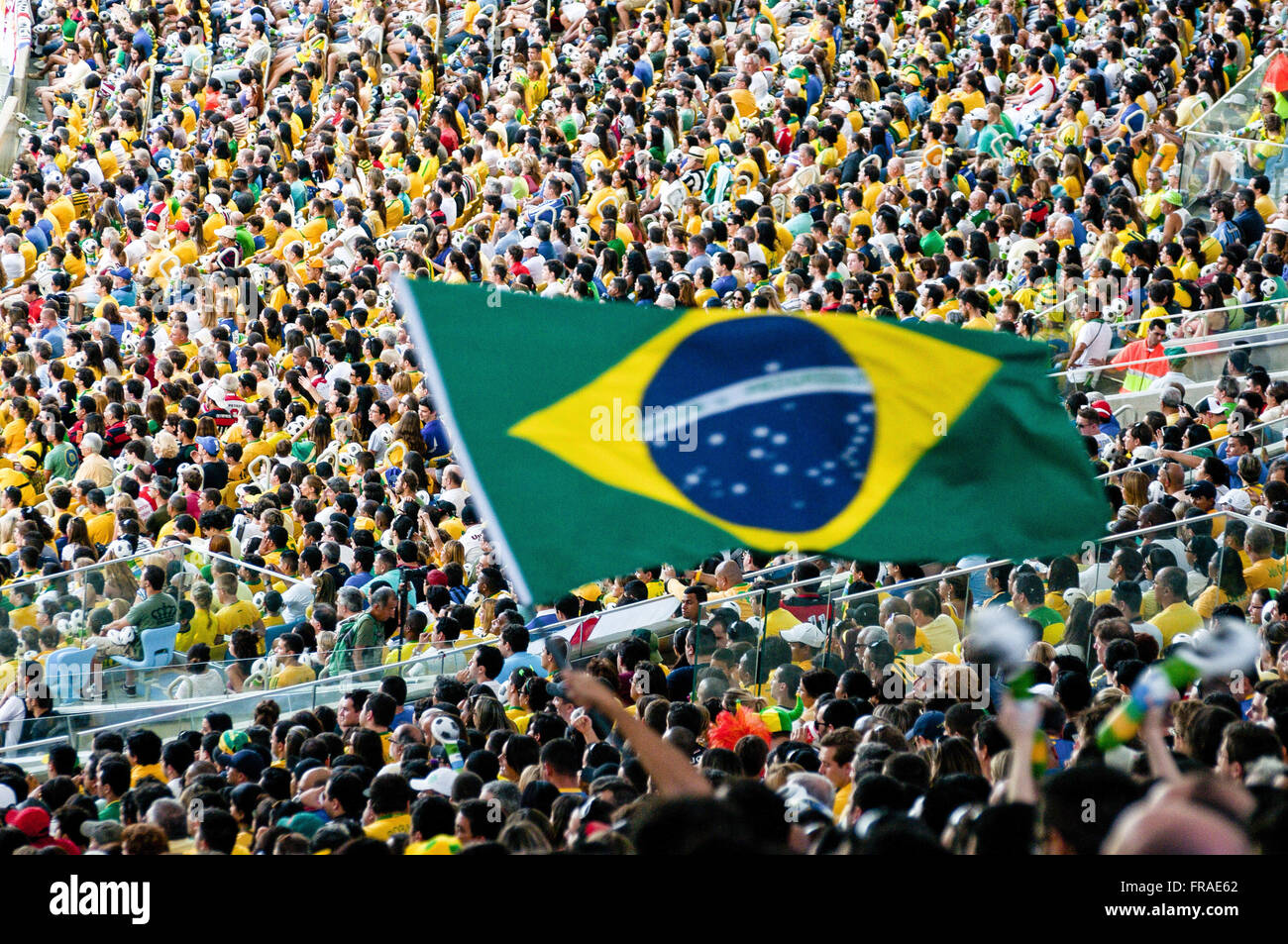 Fans at Estadio do Maracana retired in the match between Brazil and England selections - Stock Image