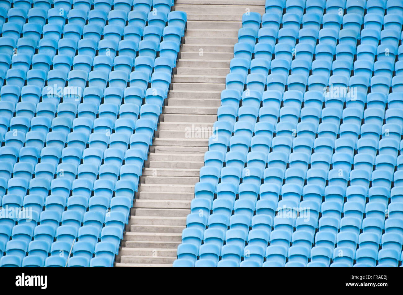Detail of blue chairs in the football stadium bleachers - Stock Image