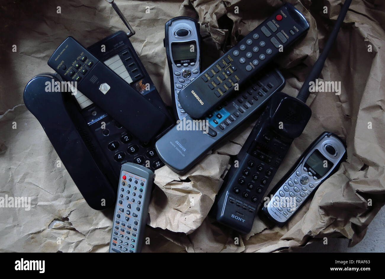 Telephone devices and old remotes - Stock Image