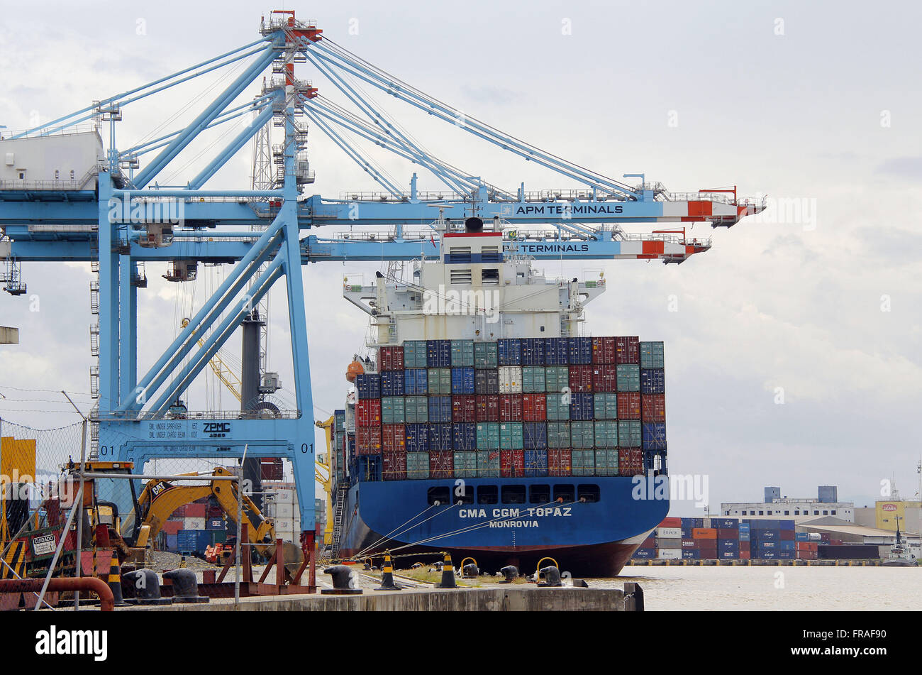 Liberian cargo ship - CMA CGM TOPAZ, MONROVIA - being loaded with containers in Port I - Stock Image