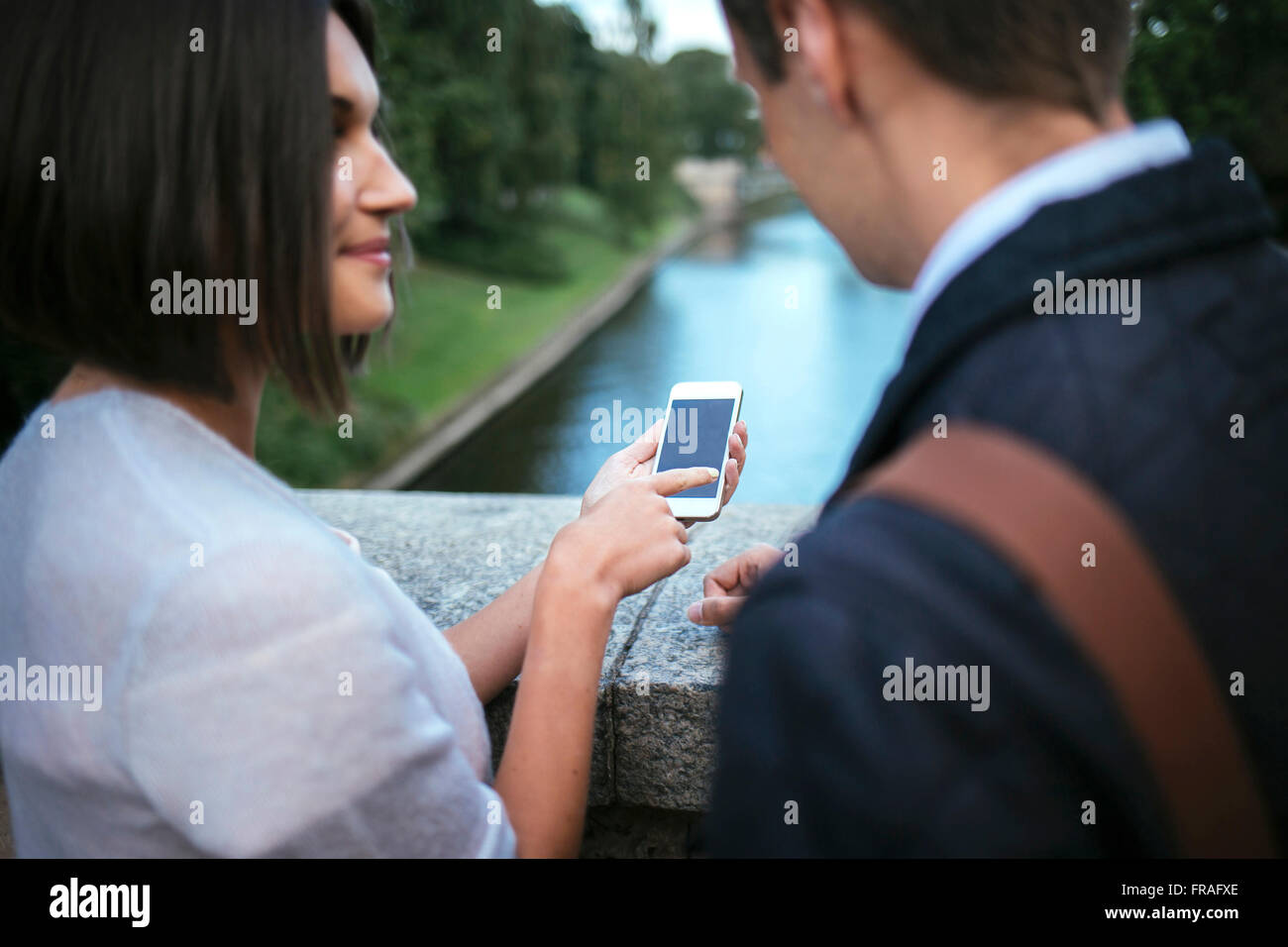 woman showing something to friend on her phone Stock Photo