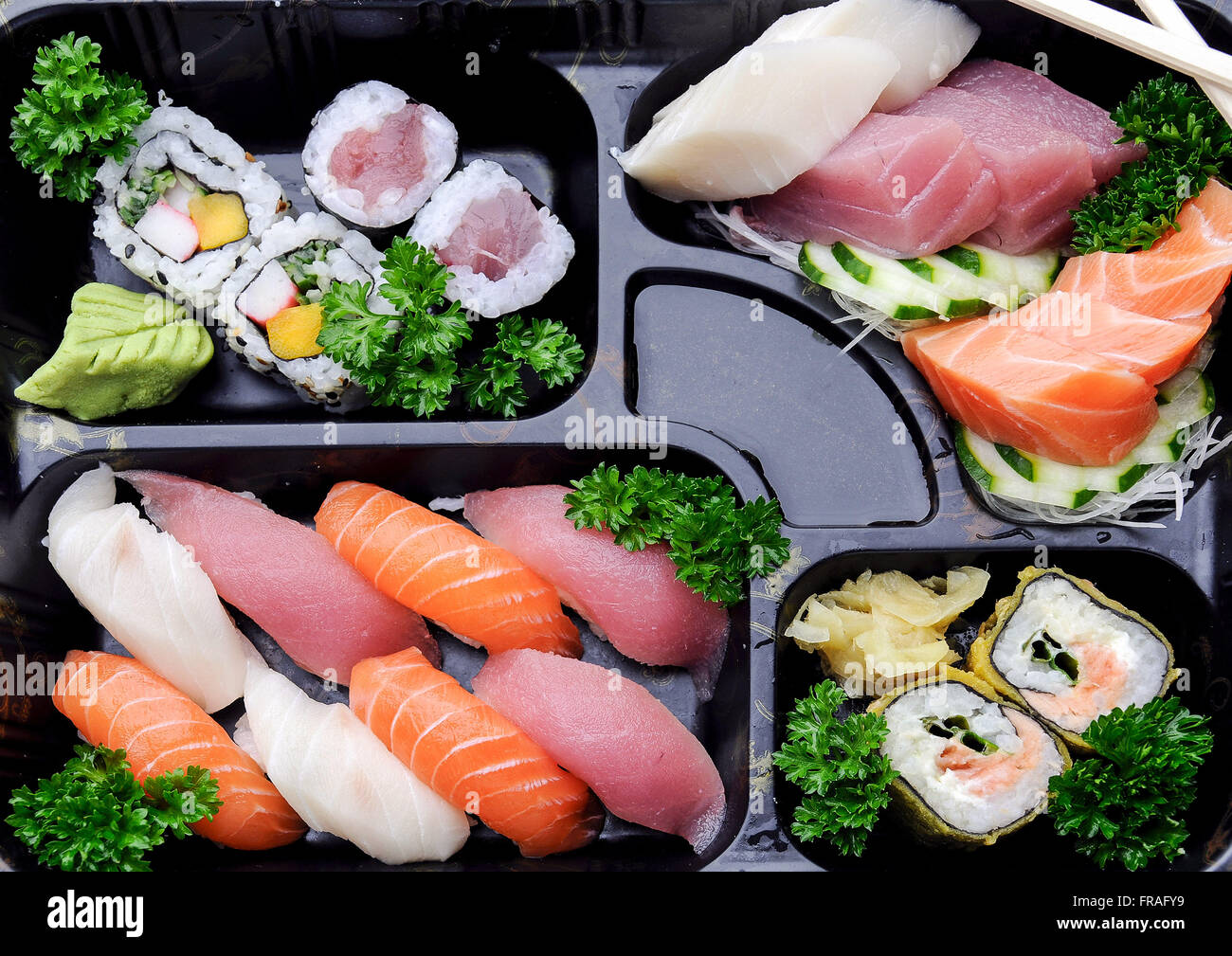 Japanese food - sushi and sashimi combination in restaurant - Stock Image