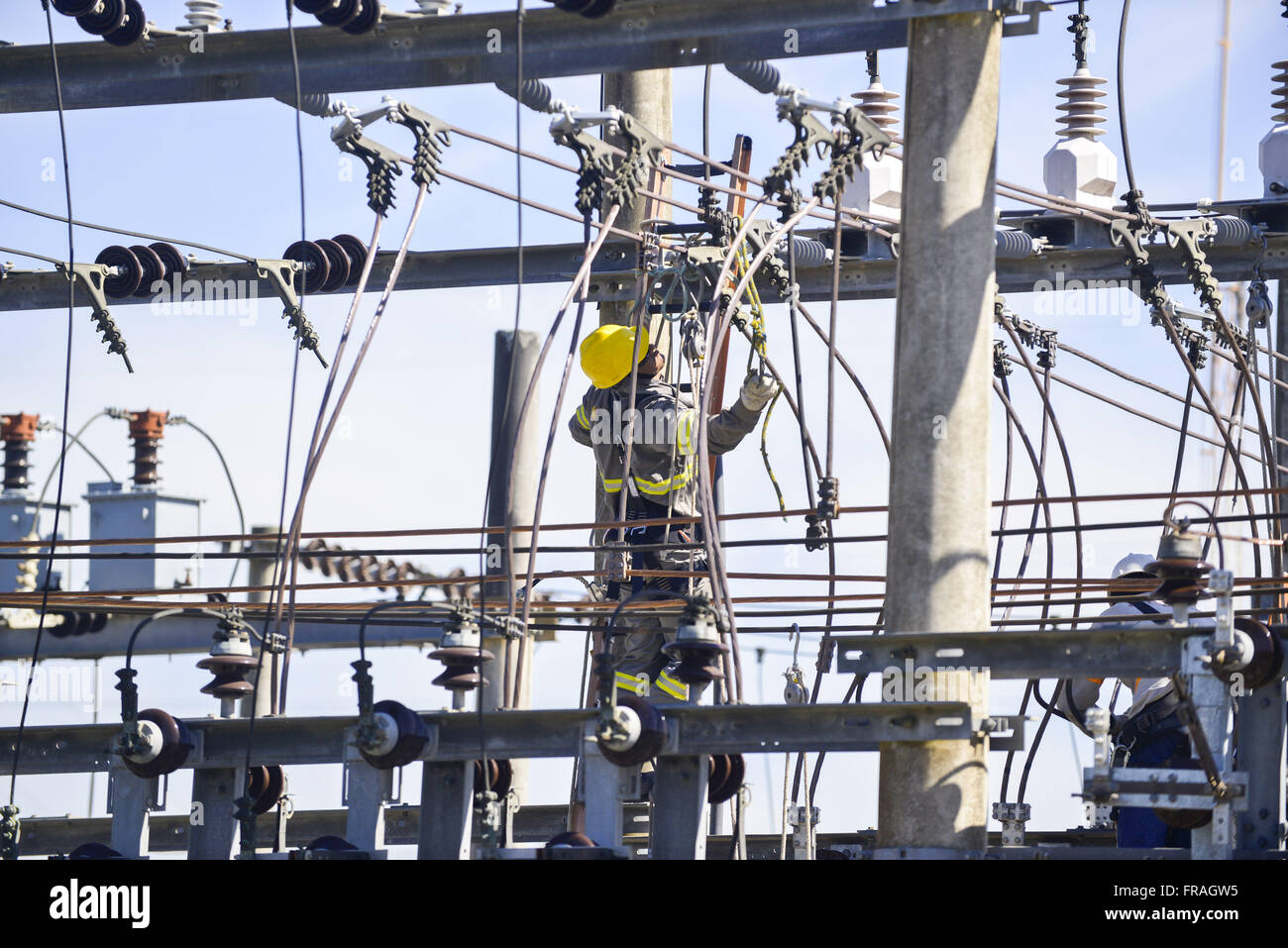 Laborer in substation WIDE - Wide Energy and Services SA - Stock Image