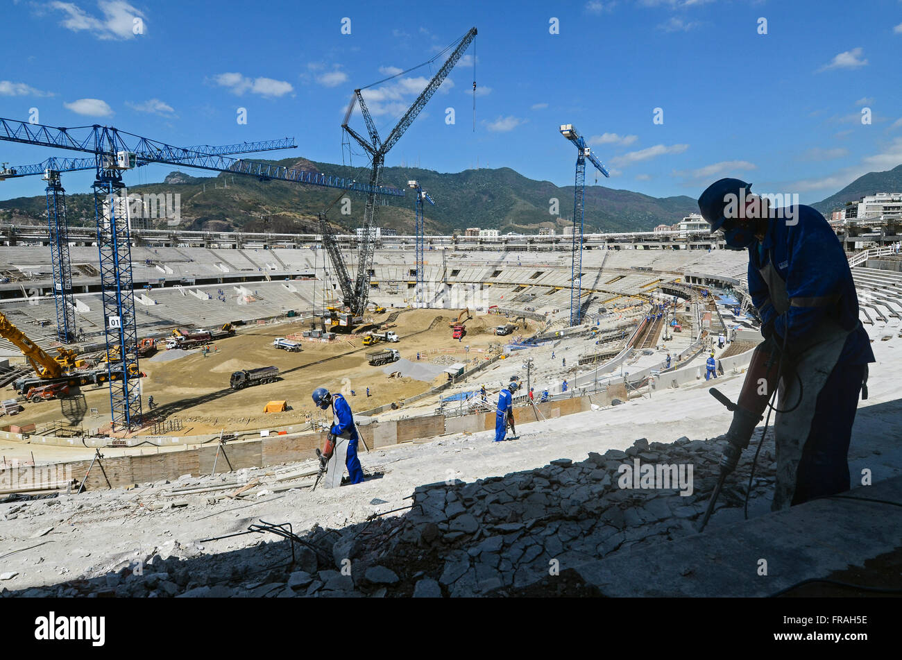 Workman with drill in the work of reforming the Estadio do Maracana for the World Cup 2014 - Stock Image