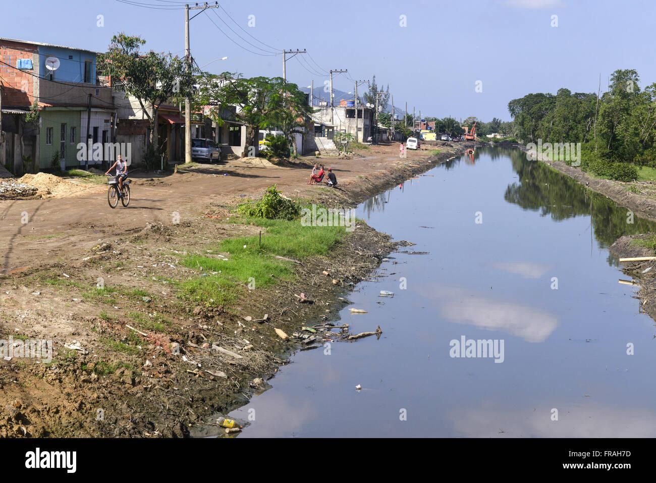 Canal in a residential area in Piraquê community - neighborhood Guaratiba - Stock Image
