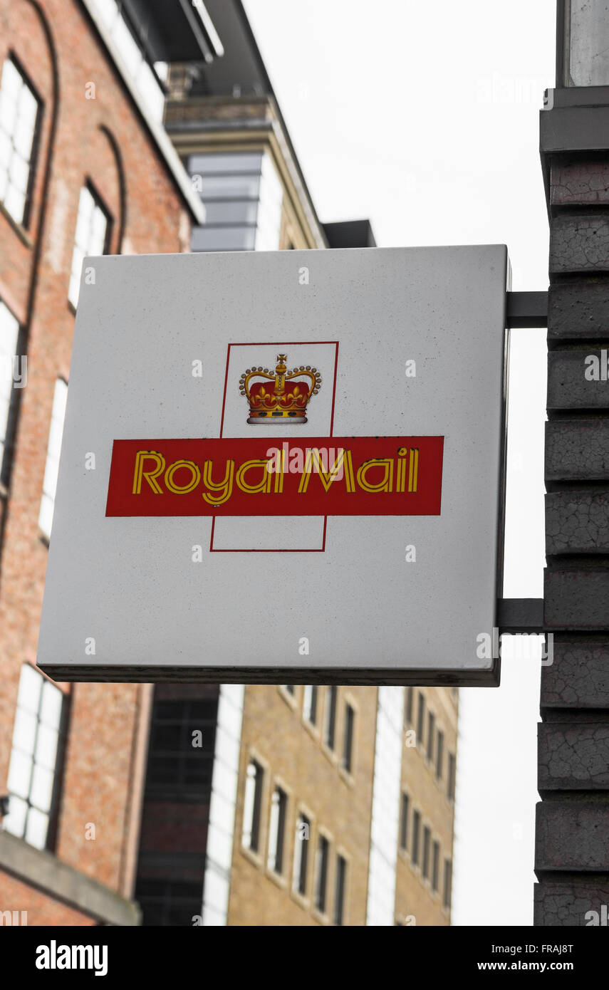 Royal Mail sign hanging from a wall - Stock Image