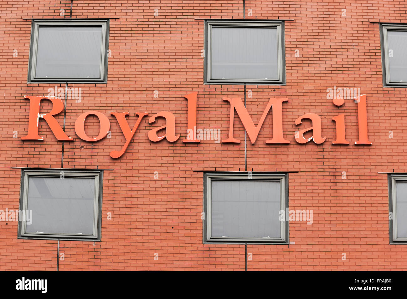 Royal mail sign on a red brick building. - Stock Image