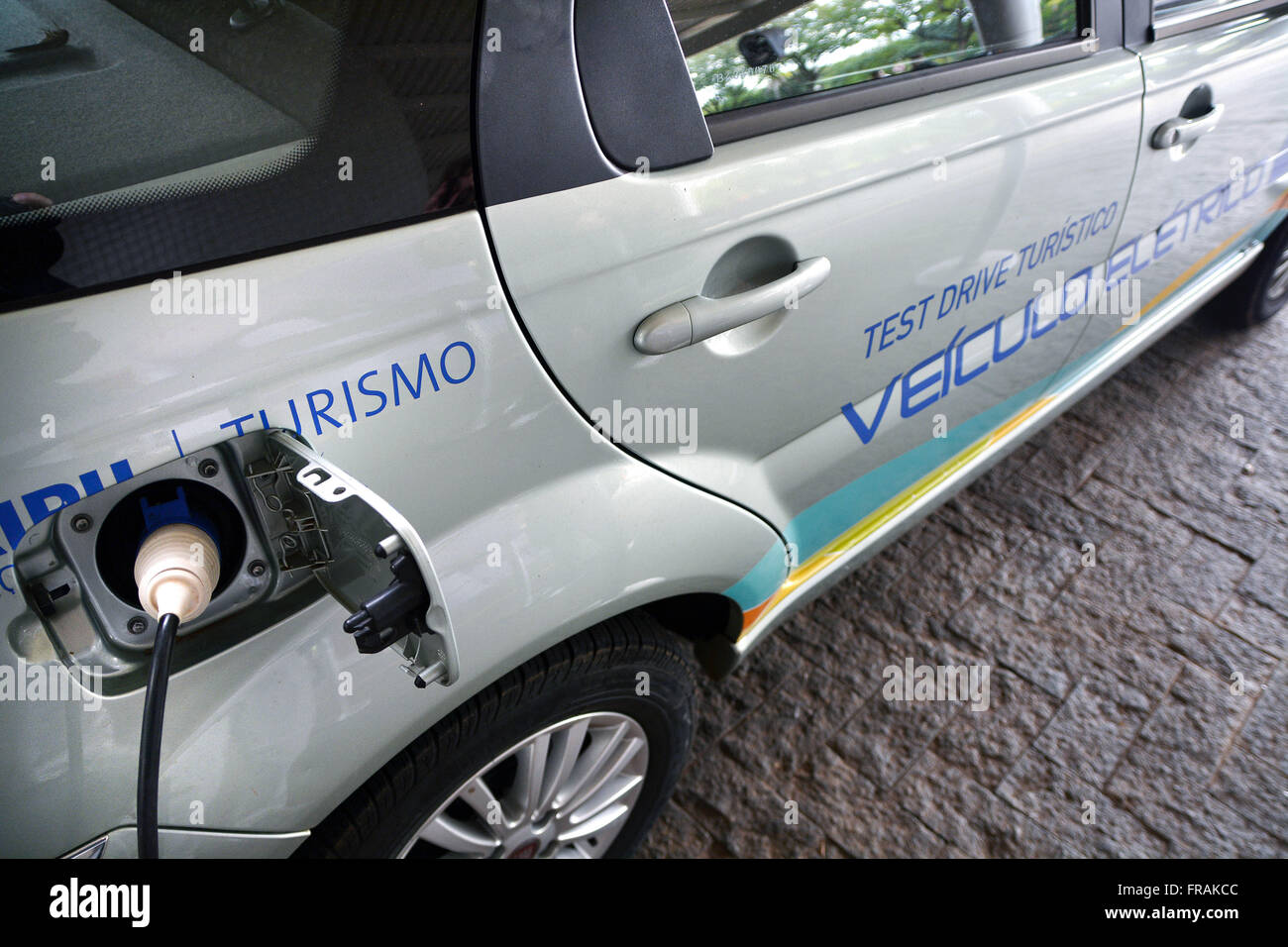 Detail of prototype electric vehicle being fueled at Itaipu Hydroelectric Plant - Stock Image