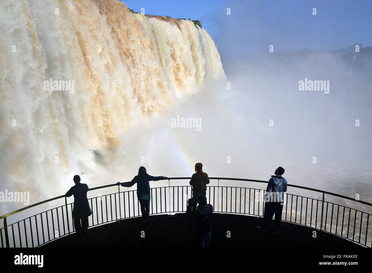 Tourists contemplating Cataratas do Iguacu - Iguacu National Park - Stock Image
