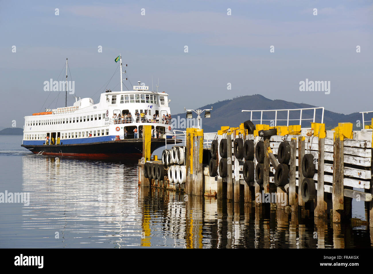 Moored at the pier of the Ferry Station on the island of Paqueta Barca - Baia de Guanabara - Stock Image