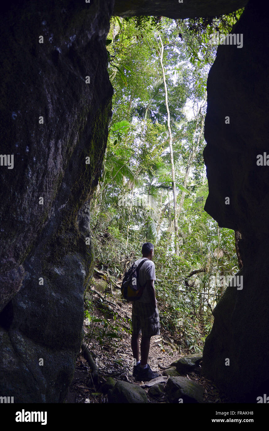 Tourist near the Bernardo de Oliveira Cave observing the native forest - Stock Image