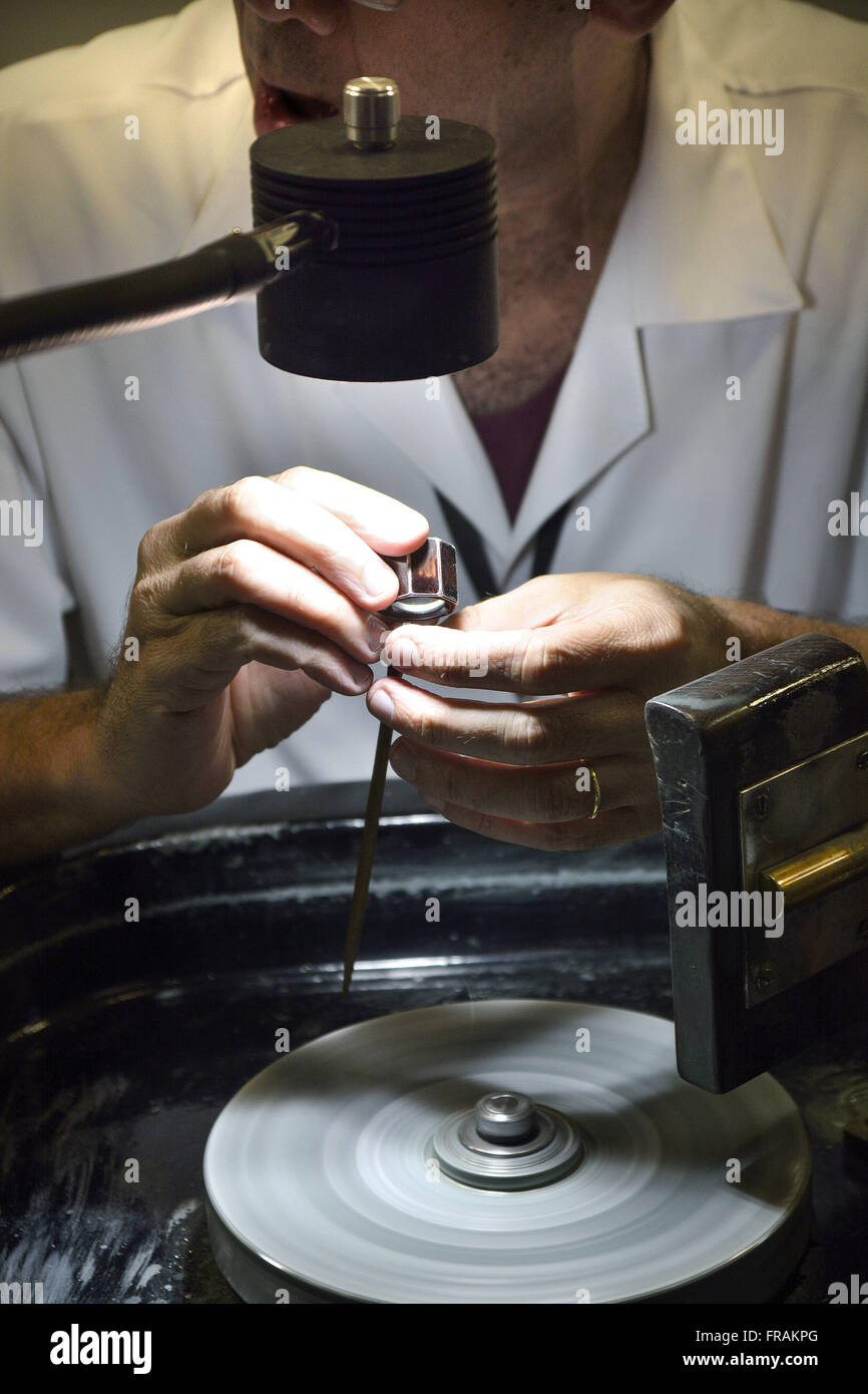 Goldsmith working in manufacturing jewelry - Stock Image