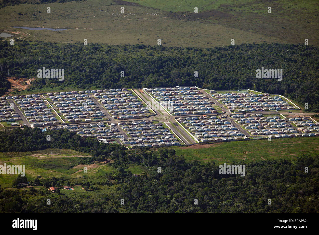Aerial view of patio from auto industry amid vegetation - Stock Image