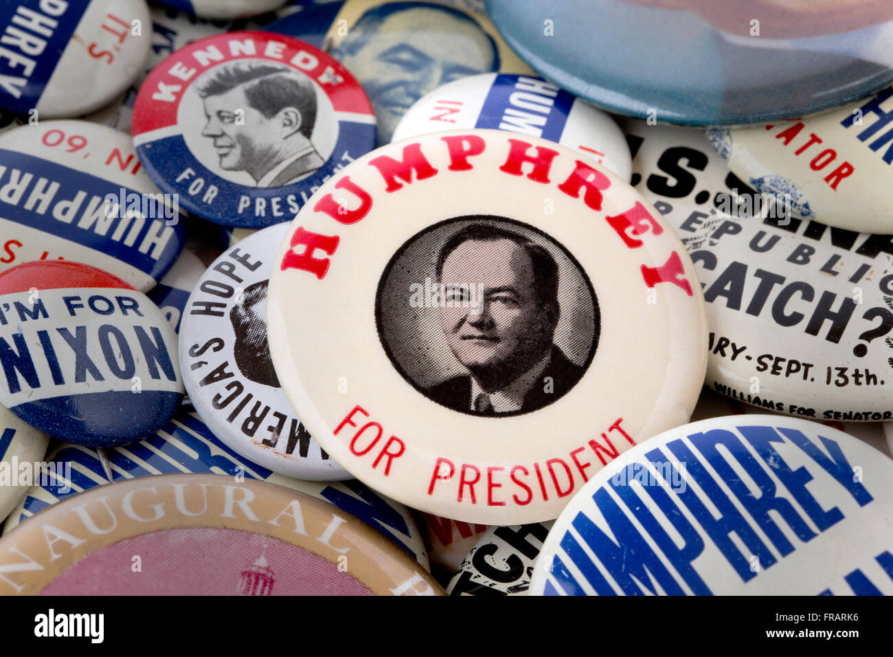 A collection of US political campaign buttons featuring a 1960 Hubert H. Humphrey pin back button badge - Stock Image