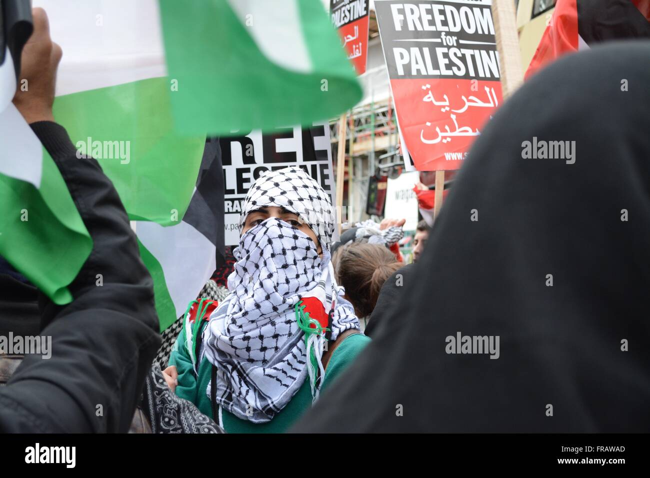 October 17th 2015. London, England. Female protester wearing a face mask joins in with a pro-Palestinian rally in - Stock Image