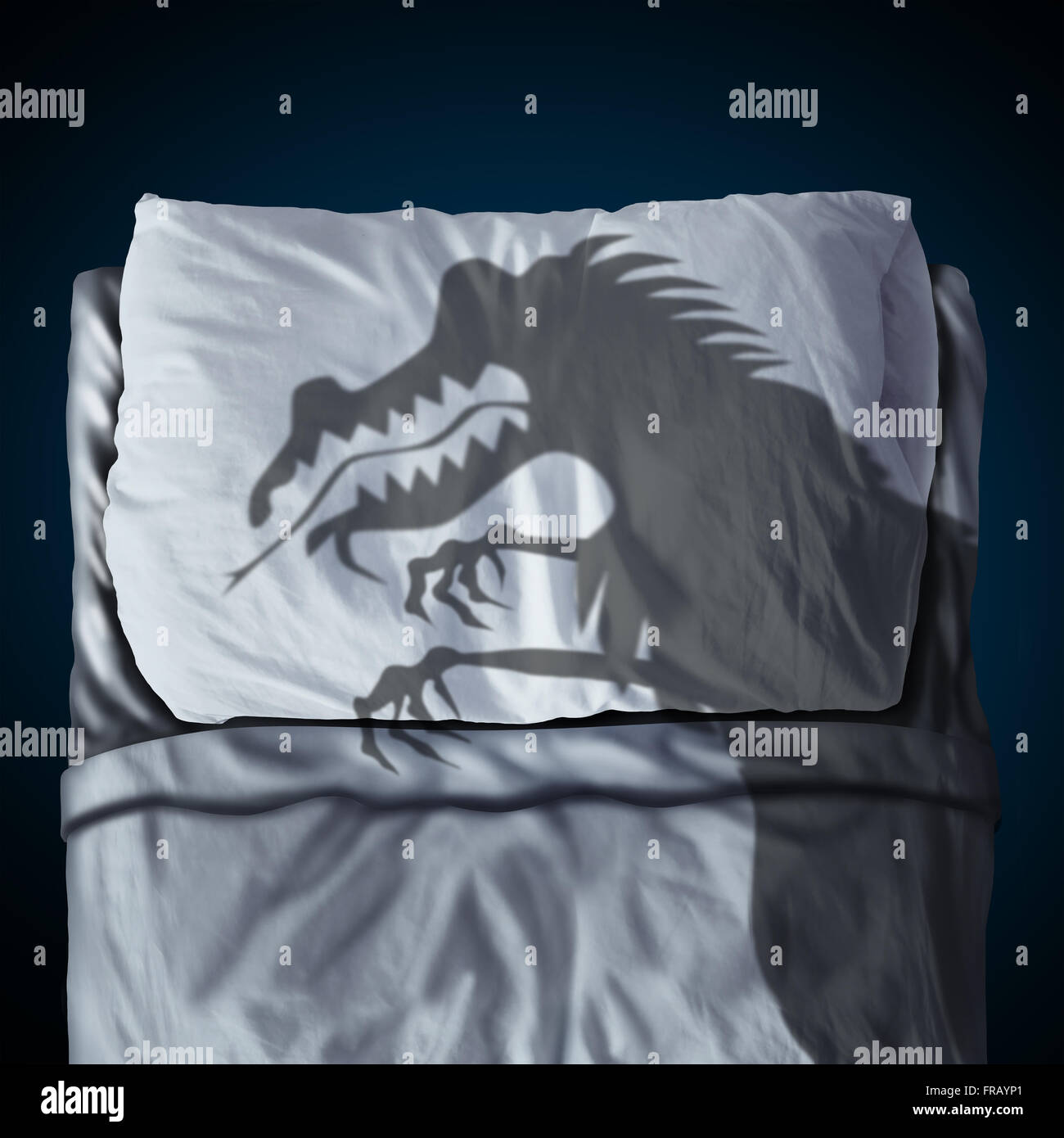Nightmare and scary night dream concept as a cast shadow of a creepy monster on a bed with a pillow on a mattress - Stock Image