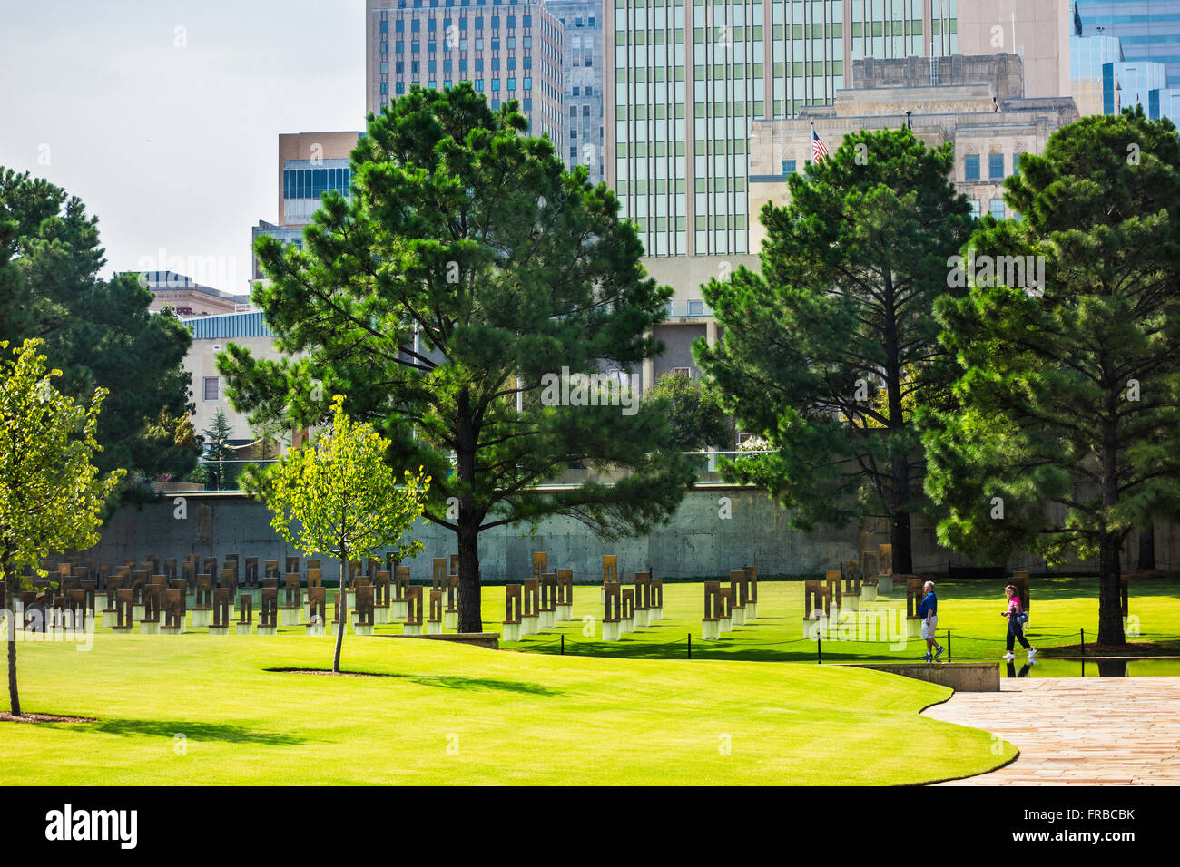 The grounds of the Oklahoma City bombing memorial, showing the Field of Chairs and city buildings. Oklahoma, USA. Stock Photo