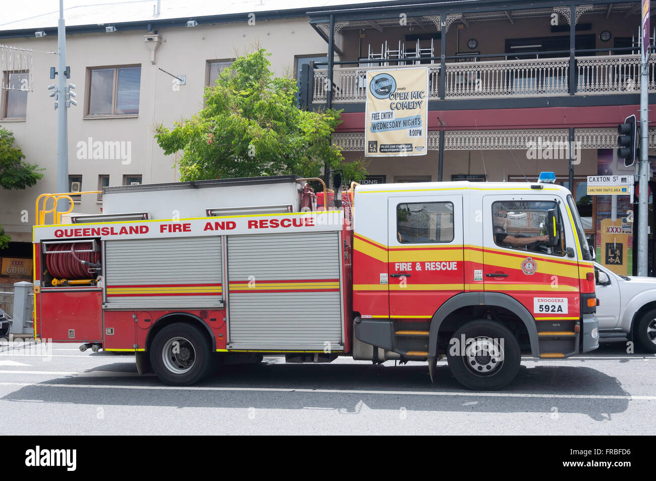 Queensland Fire and Rescue engine on call, Caxton Street, Paddington, Brisbane, Queensland, Australia - Stock Image