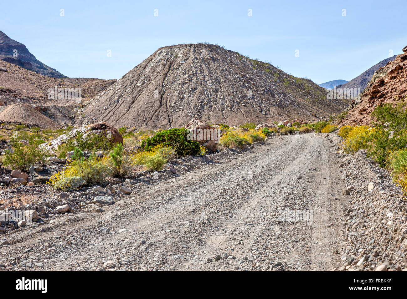 Ore debris accumulation next to Grantham Talc Mine site in Warm Springs Canyon, Death Valley National Park. - Stock Image