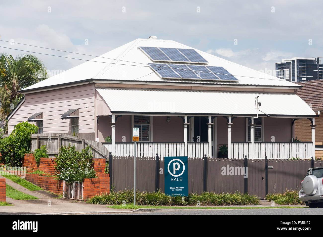 Period wooden home with solar heating panel on roof, Campbell Street, Paddington, Brisbane, Queensland, Australia - Stock Image