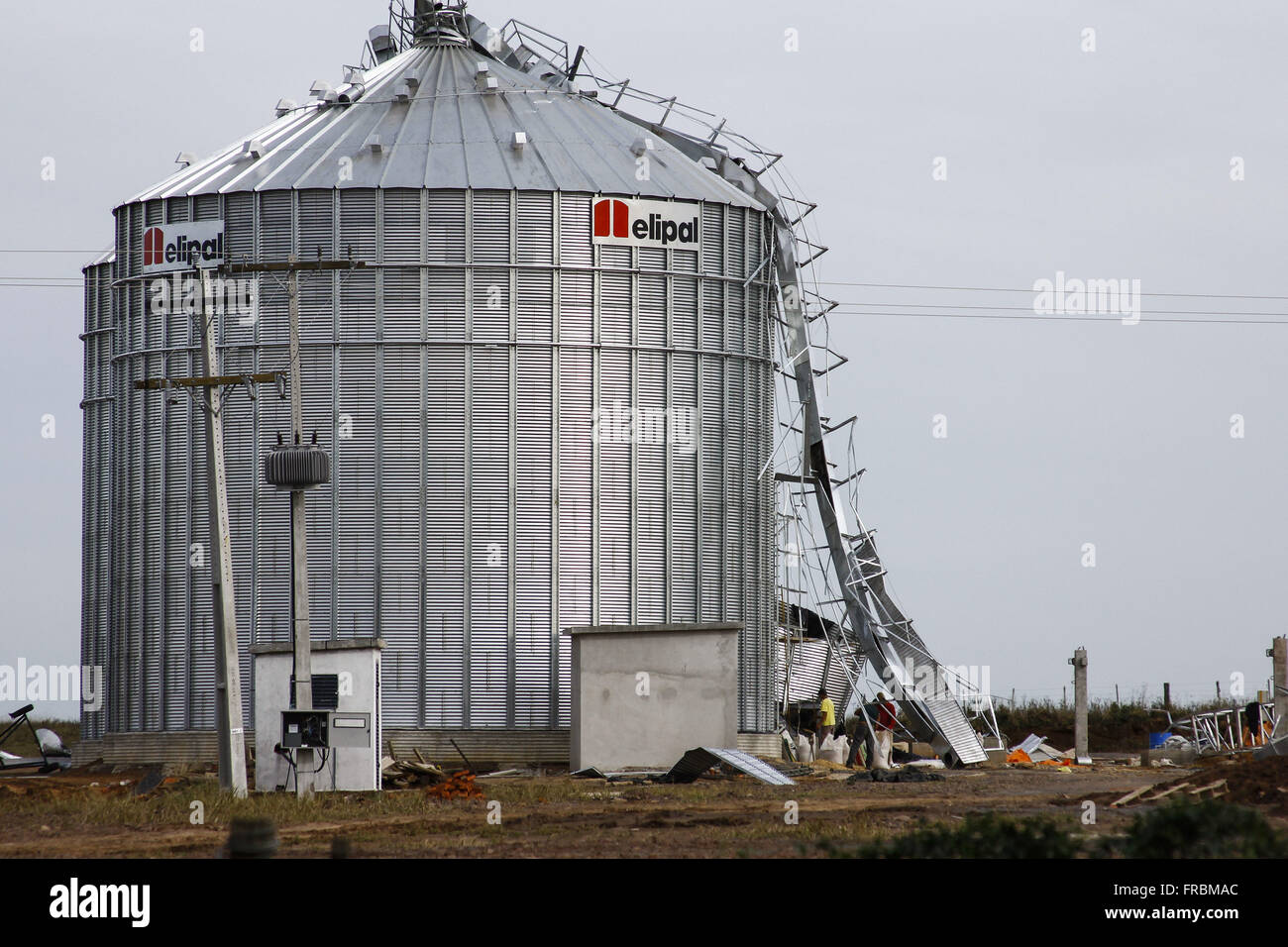 Damage caused by gale in storage silo - Stock Image