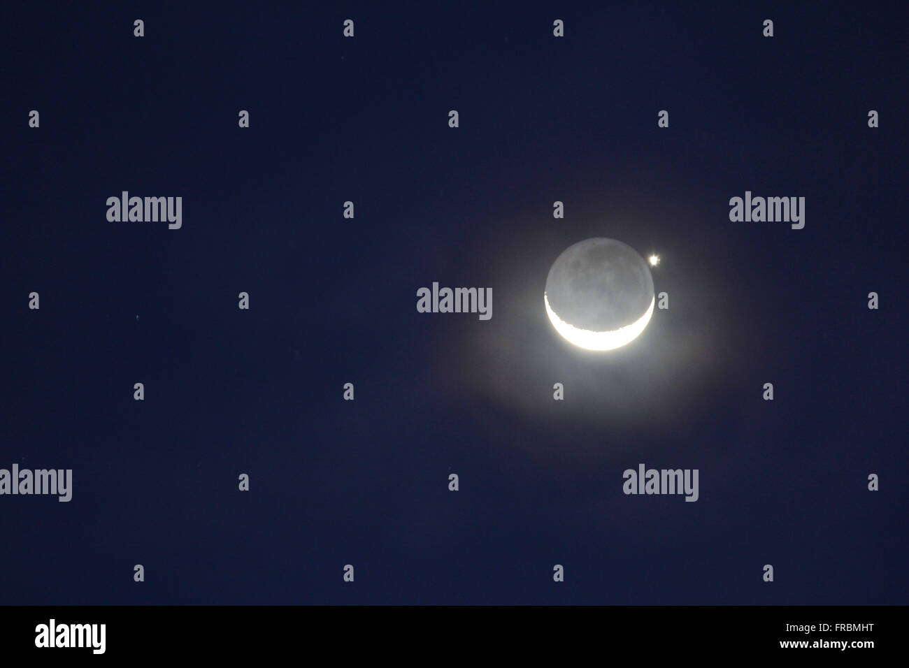 Moon and planet Venus viewed together - Stock Image