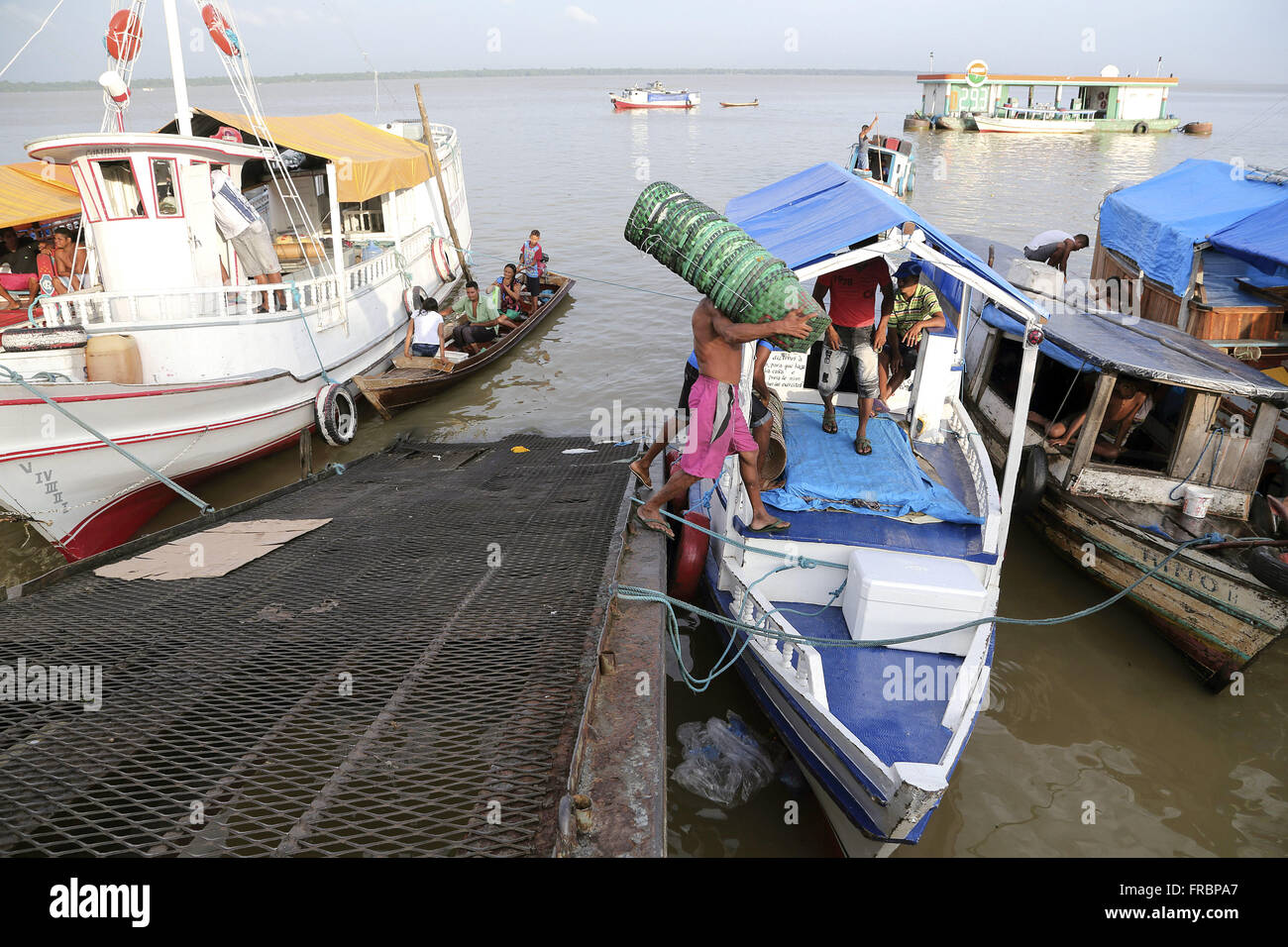 Loading merchandise moored boats near the Fair Acai, Guajará Bay - Stock Image